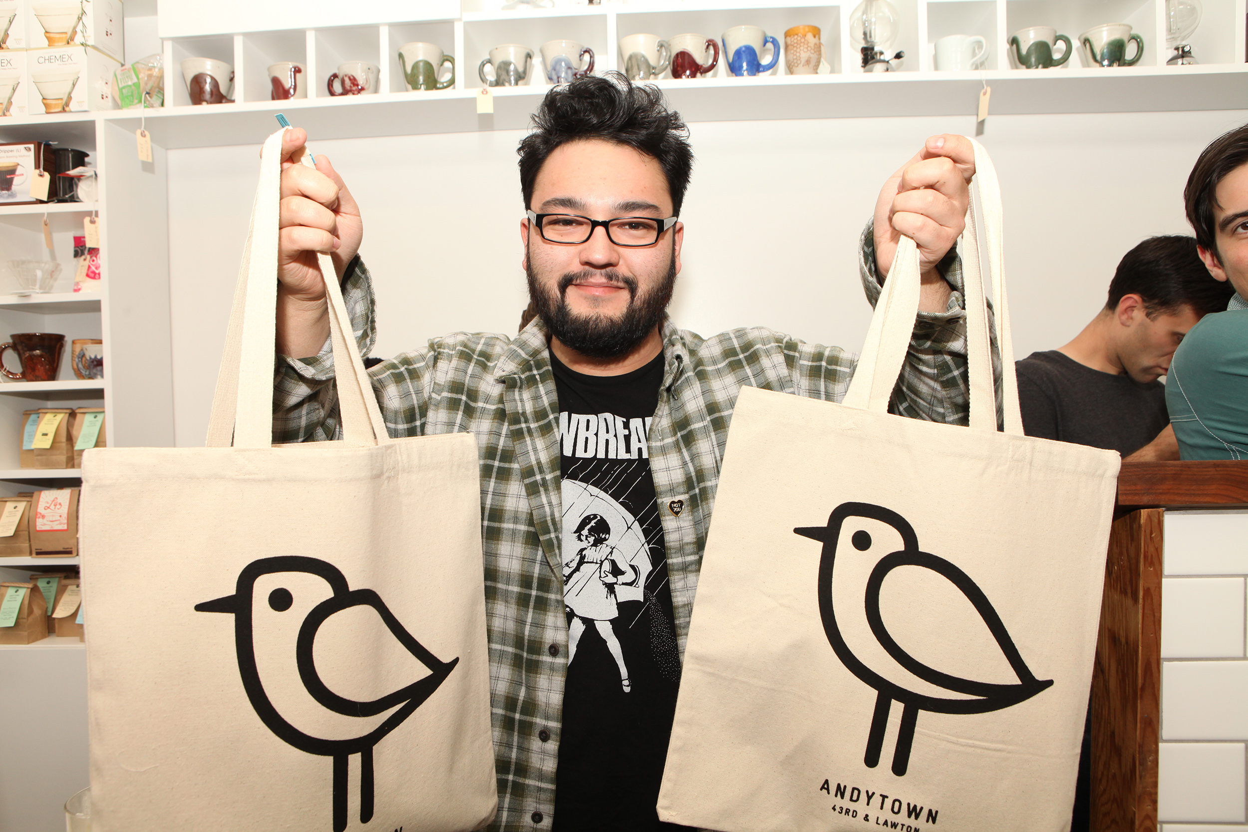 Some of Andytown's bird merch. (Photo courtesy Andytown Coffee Roasters.)