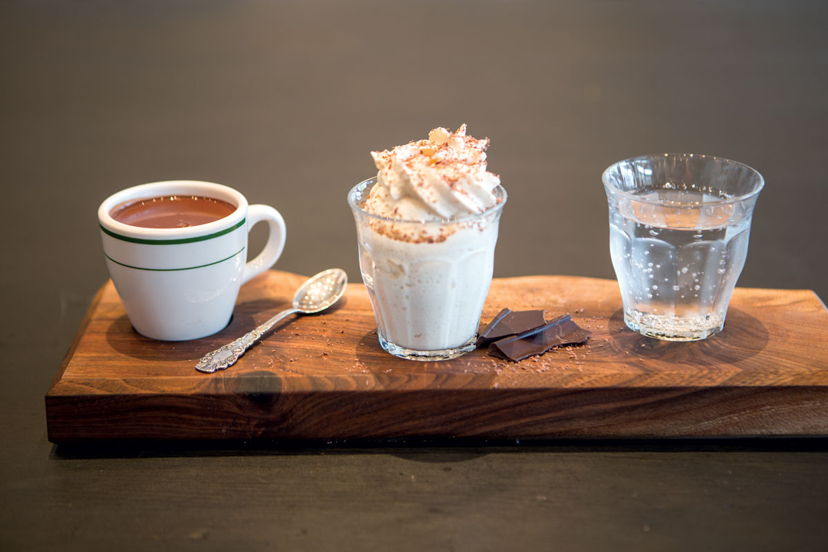 A pairing trio with seltzer, whipped cream, and dark drinking chocolate.