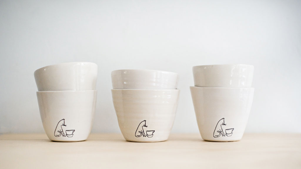 Comins tea bowls, with logo inspired by their cat, Anders.