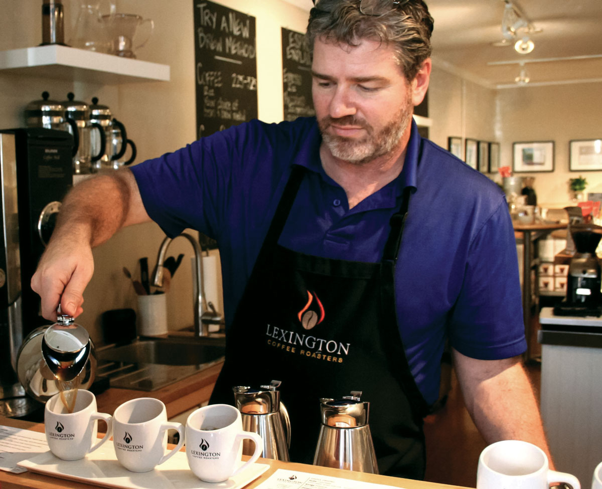 Barista David Tilley pours a flight at Lexington Coffee Roasters' tasting bar. (Photo: courtesy Amira Hegazy.)
