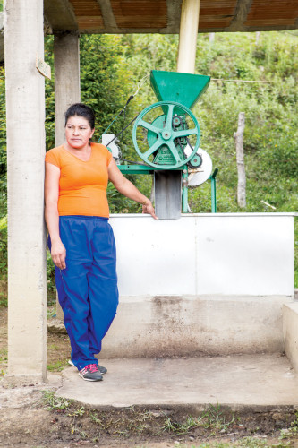 Silvia Higuita stands at her washing station. Her coffee won this year's Antioquia Best Cup competition.
