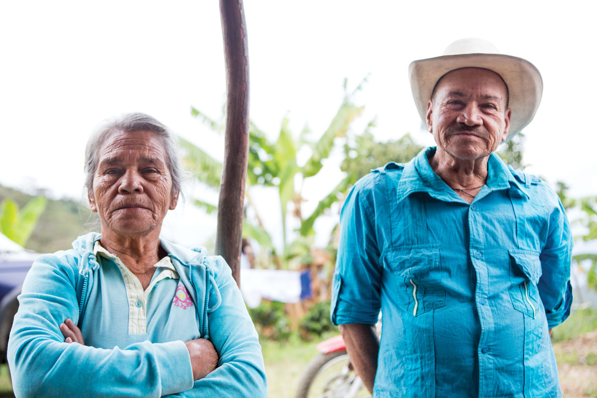 Neighbors Diocelina, sixty-eight, and Alfredo de Jesus Lopez, seventy, farm coffee on a plot down the road from the Salas Higuitas.