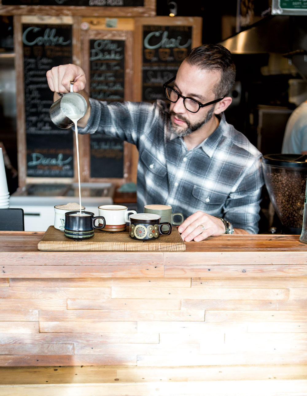 Nate Snell, who owns Pip's Original with his wife, Jamie, pours a chai flight at the Portland café. (Photos: Cory Eldridge.)