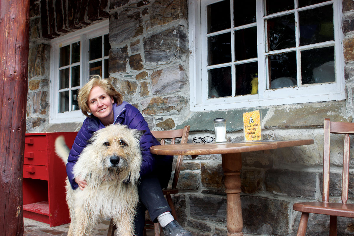 Plain of Six Glaciers Teahouse owner Susanne Gillies-Smith with her dog, Arlo-Barlo. (Photos: Jessica Natale Woollard.)