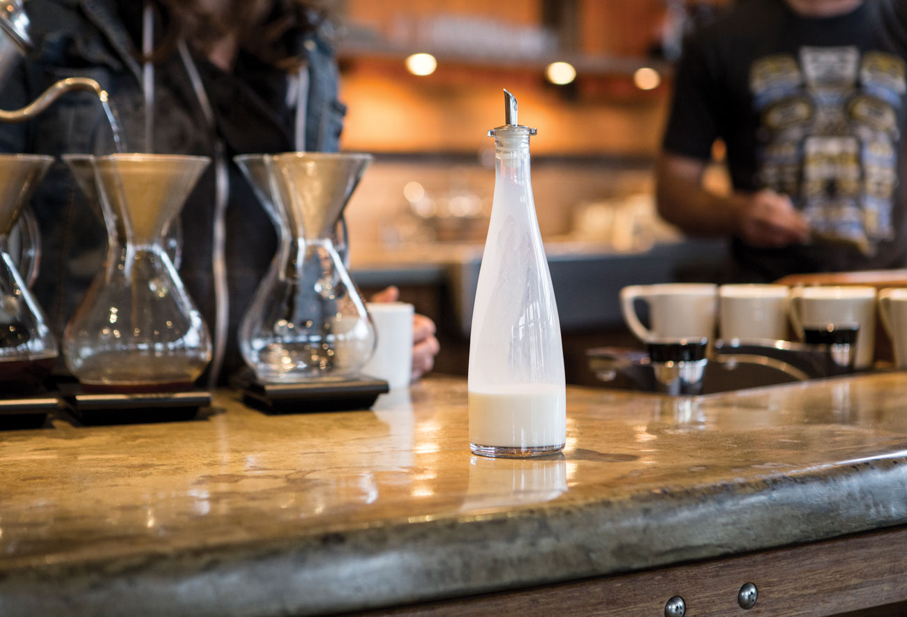 Milk is offered by request at Coava Coffee Roasters café in Portland. Above, the condiment bar at Birch Coffee in Manhattan. (Both photos: Cory Eldridge.)
