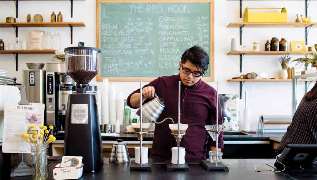 A barista makes a pour-over at the Red Hook in Ferndale, a Detroit suburb. (Photo: Chris and Michelle Gerard.)