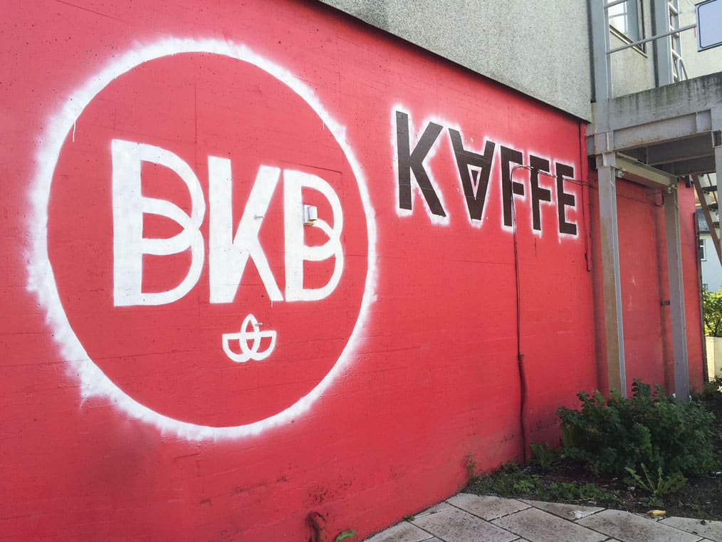 A brightly painted wall outside Bergen Kaffeebrenneri; bergen coffee