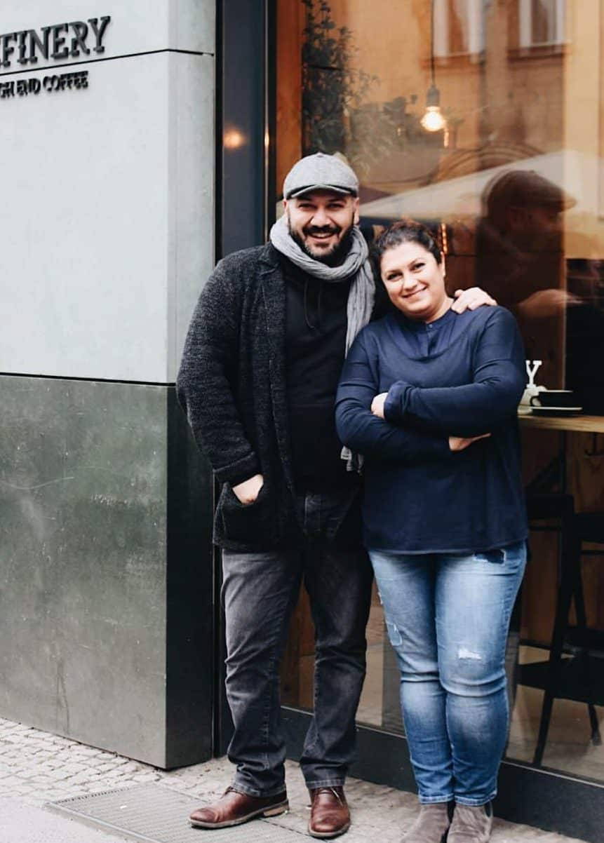 Bora and Tansel Özbek stand in front of the Refinery café.